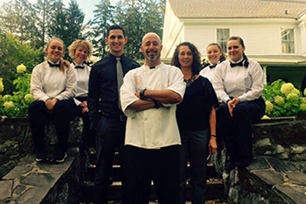 group of men and women in catering attire