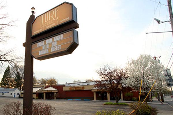 turf tavern sign overlooking parking lot