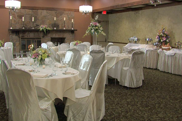 private catering space set with linens and banquet tables set