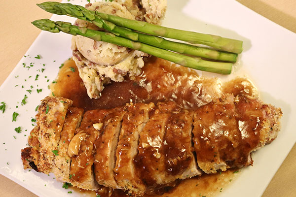 meat dish with asparagus and gravy